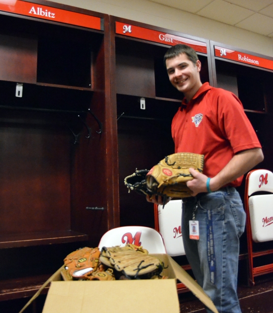 Redbirds Director of Operations Mark Anderson with box of donated gloves besides Albitz Locker.