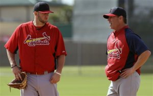 Matt Adams and Jim Edmonds (Photo: AP Photo/Julio Cortez)