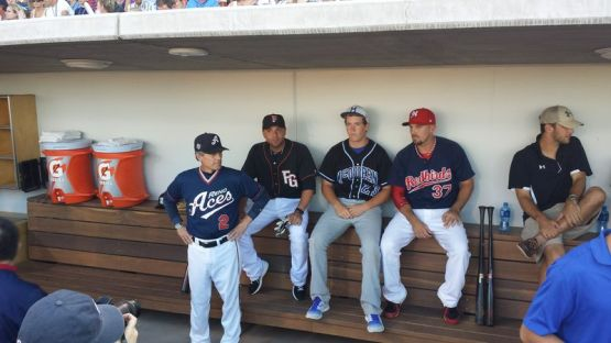 (Jared Ravich/MiLB.com) Brock watches from the dugout with Reno Manager Brett Butler, Johnny Monell and Kody Reynolds.